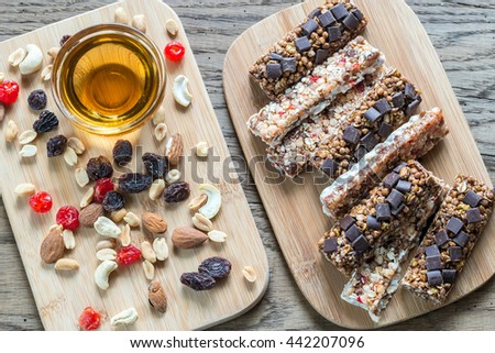 Granola bars with dried berries and chocolate - stock photo