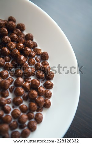Granola. Corn balls with milk. Dietary food. This is a close up macro shot of breakfast cereal in a bowl - Shot with a shallow depth of field - stock photo