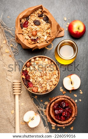 Granola, dried berries, nuts and honey. Fitness breakfast. Top view - stock photo