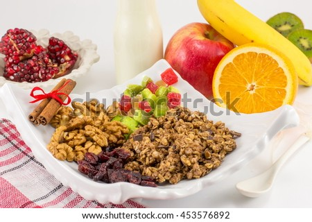 Granola Muesli with fruit ingredients for a healthy breakfast - stock photo