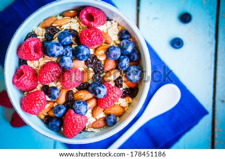 Granola with berries and almonds in a bowl - stock photo