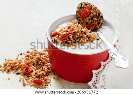 Granola with chia seeds, flax seeds, sesame seeds and goji berries, selective focus - stock photo