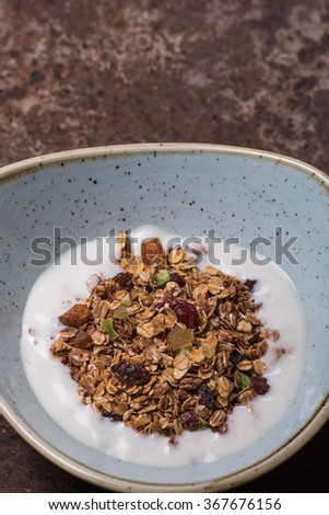 Granola with dried fruits in a bowl
