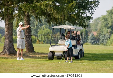 Granpa Instructing Grandson in Golfing - stock photo