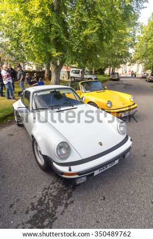 GRANTOWN ON SPEY, SCOTLAND - SEPTEMBER 6: Classic Porsche 911 Carrera line up on September 6, 2015 in Grantown On Spey, Scotland