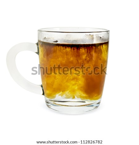 Granulated coffee in a glass mug with hot water isolated on white background