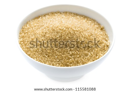 granulated demerara sugar in a bowl isolated on white