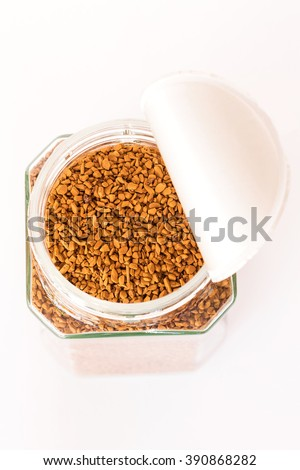Granules of instant coffee in a glass bottle with open cap, smell good : top view - stock photo