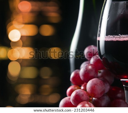 grape and glass with red wine  - stock photo