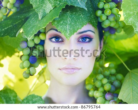 Grape goddess. Beautiful young lady wrapped in grape - stock photo