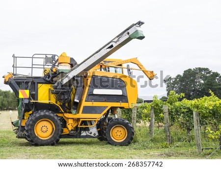 Grape harvester poised to start harvesting a crop - stock photo