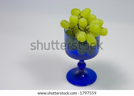 grape in blue glass - stock photo