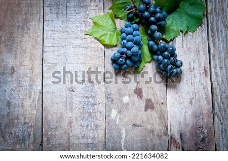 Grape on a wooden table - stock photo