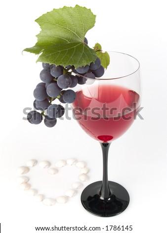 grape-vine and wine on white background - stock photo