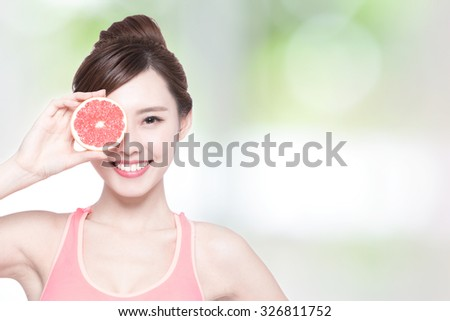 grapefruit and beauty - The woman is dieting healthy with nature green background, asian - stock photo