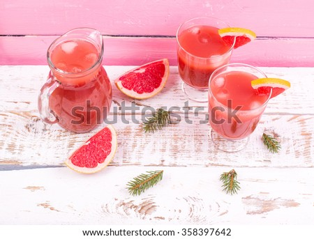 Grapefruit juice in a jug on a table, Grapefruit juice, fresh drink grapefruit juice - stock photo