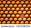 Grapefruit slice amongst many whole grapefruits - stock photo