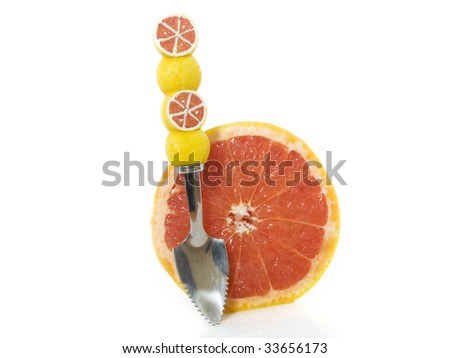 Grapefruit with a spoon on a white background