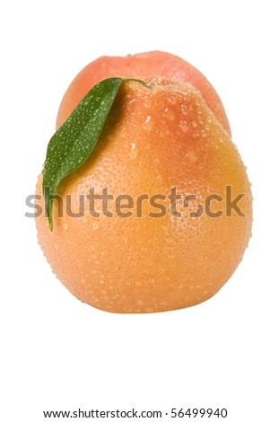 Grapefruit with drops of dew on a white background - stock photo