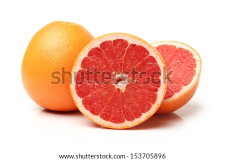 Grapefruit with segments on a white background  - stock photo