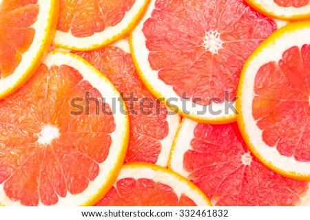 Grapefruit with slice  on white background,  top view