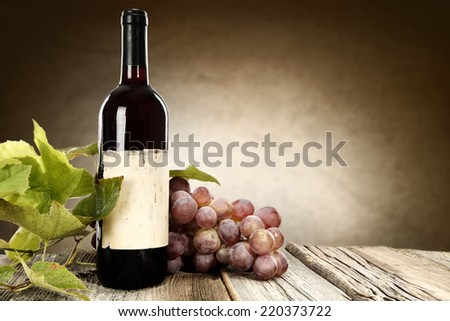 grapes and bottle of wine  - stock photo