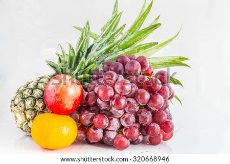 Grapes and fruits on isolated background. - stock photo