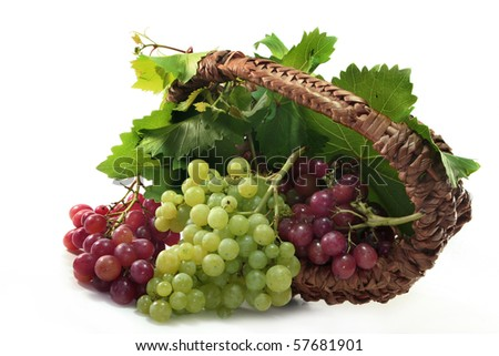 Grapes and vine leaves in a basket - stock photo