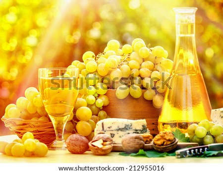 Grapes and wine on table - stock photo