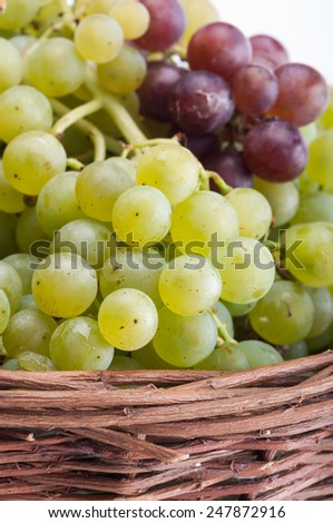 Grapes in a wicker basket. - stock photo