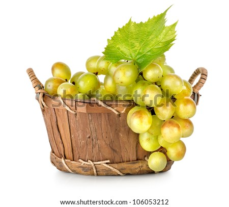 Grapes in a wooden basket isolated on white background