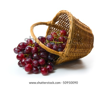 Grapes in a wooden basket. White background - stock photo