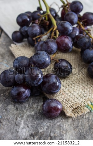 Grapes on a old wooden table. Close up - stock photo