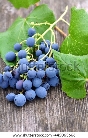 Grapes on a wooden background - stock photo