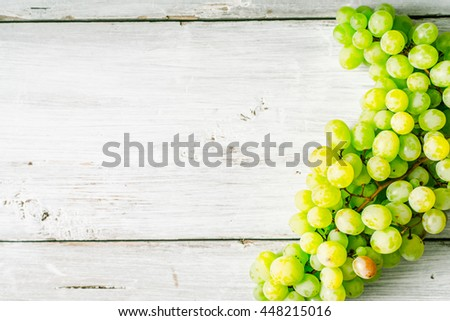 Grapes on the white wooden table horizontal