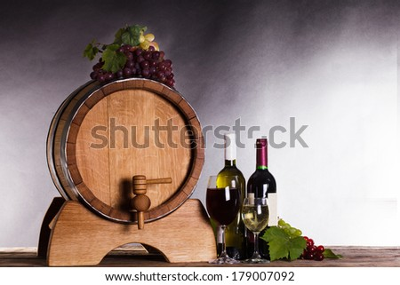 Grapes on wooden barrel with wine on a white - stock photo