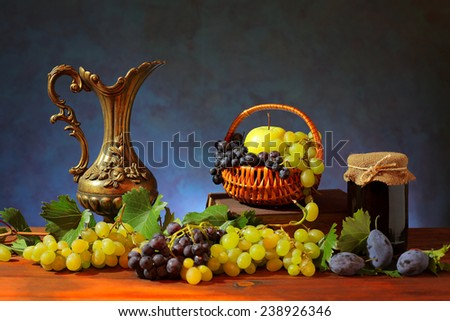 Grapes, vine and jam on a wooden table - stock photo