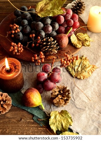 Grapes with candles.image of autumn.