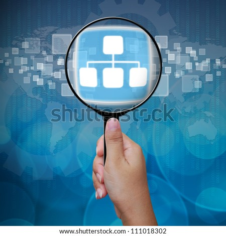 Graph button in Magnifying glass - stock photo
