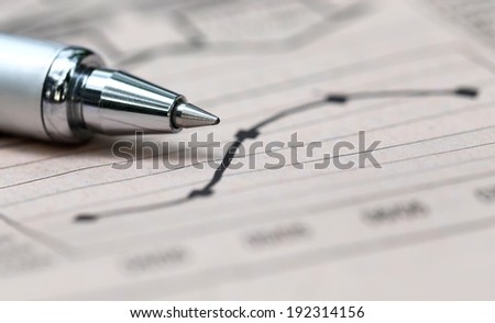 Graph chart  with pen on paper  - stock photo