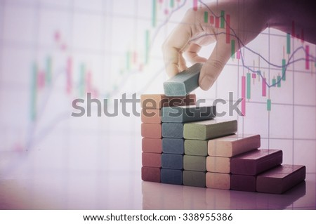 graph from block wood with hand and money concept - stock photo