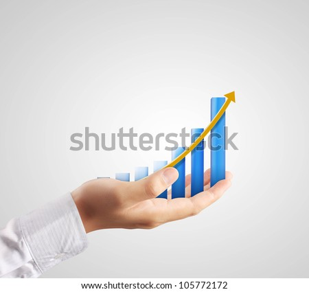 Graph on hand, local businessmen - stock photo