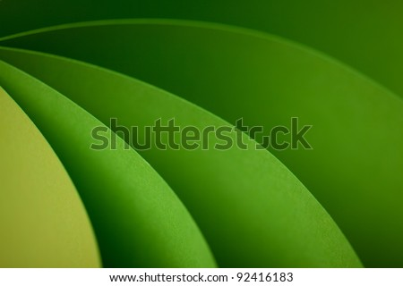 graphic abstract image of colorful origami pattern made of curved sheets of paper - stock photo