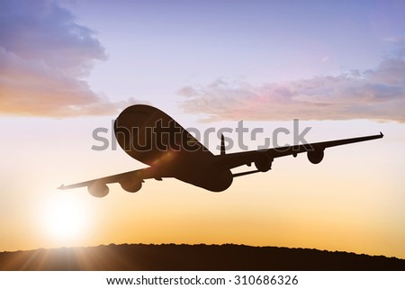 Graphic airplane against sun shining