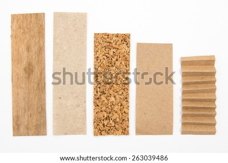 Graphic columns set with wood, cork, carton isolated on a white background. Useful for infographics about ecology - stock photo