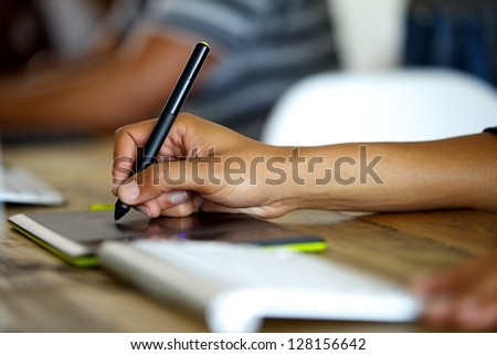 Graphic designer using tablet - stock photo