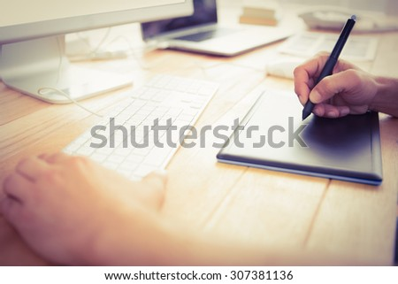 Graphic designer working with digitizer in the office - stock photo
