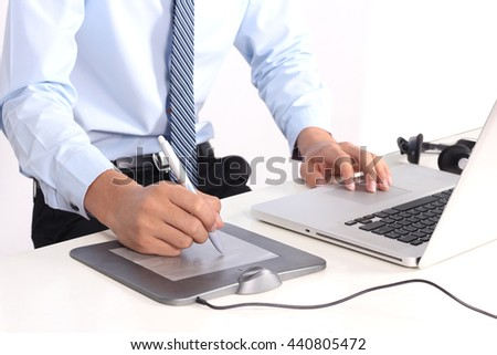 Graphic Designer working with interactive pen display, digital Drawing tablet and Pen on a computer. - stock photo