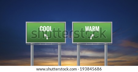 Graphic of a green warm and cool sign on sunset background - stock photo