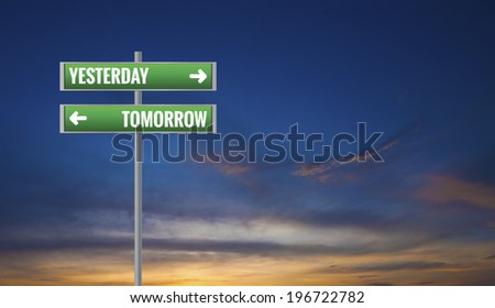 Graphic of a Yesterday and Tomorrow Road Signs on Sunset Background - stock photo